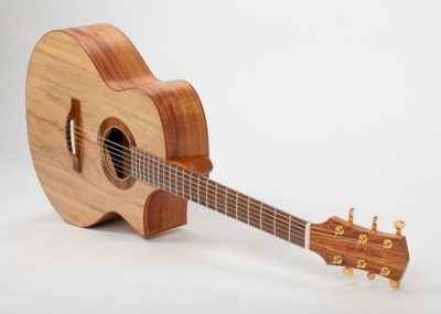 The Glenn Bird Belle Grand, with or without cutaway, is a more modern looking acoustic guitar. Because of the larger area in the lower bout it has a fuller even tone.