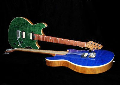 Handmade GR3 electric guitars in blue and green