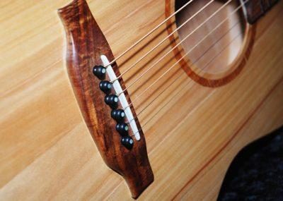 Handmade Glenn Bird guitar showing bone bridge piece