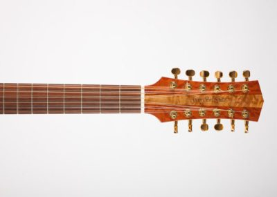 The twelve string headstock has Western Australian She Oak veneer and a Birds Eye Maple name strip. The neck has a bone nut which is common to all Glenn Bird Guitar models because of the better sound you get. This guitar also features a Santos Rosewood fretboard.